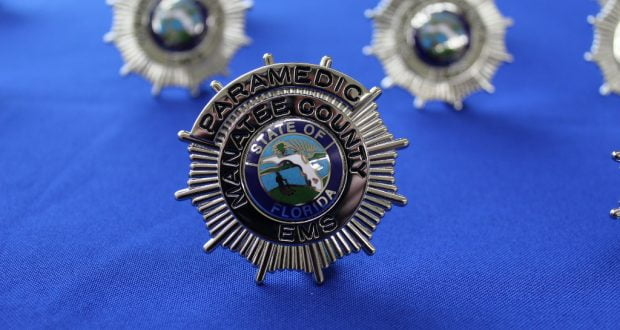 The photo shows a close up of a Manatee County EMS badge.