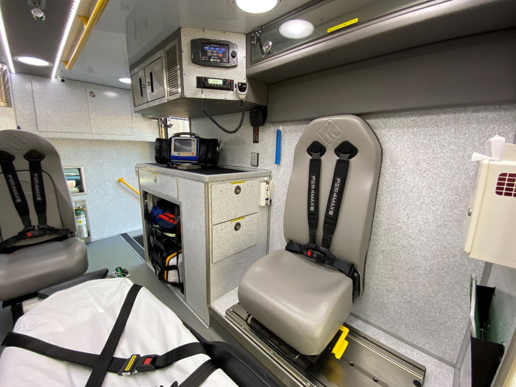 Instead of a bench seat on the curb side, the Road Rescue rigs for Lexington County have an EVS mobility seat that swivels and slides fore and aft on a track set into the floor. Note the door forward design on the curb side, to the right of the attendant seat, which allows cabinetry and equipment to be located close at hand for the paramedic.