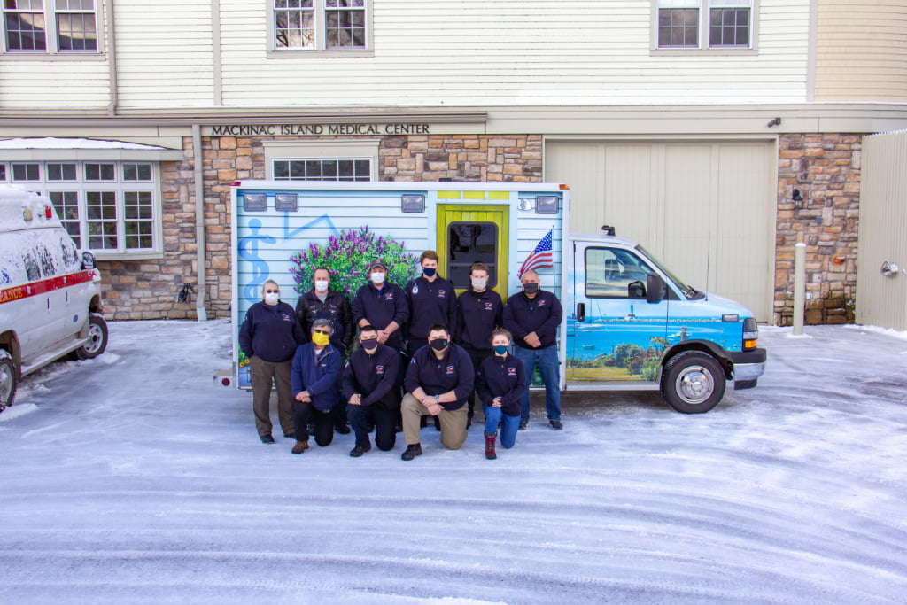 Mackinac Island EMS paramedics and emergency medical technicians pose with their new rig.